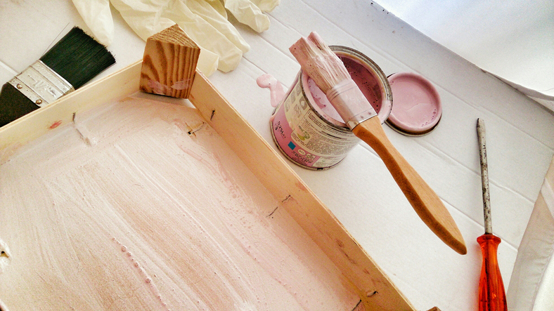 High Angle View Of Paint Can And Paintbrush On Table