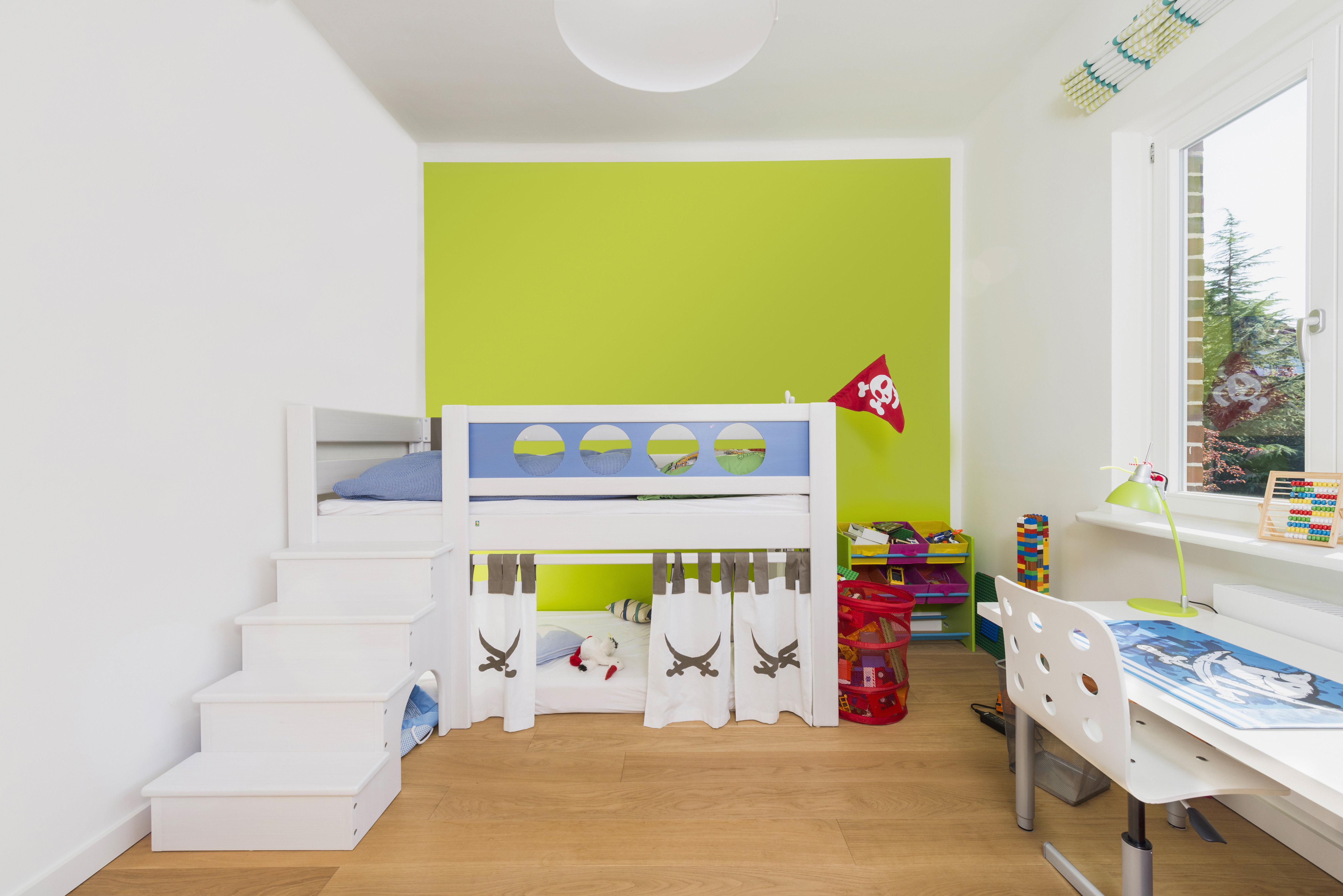 Modern children's room with wooden floor