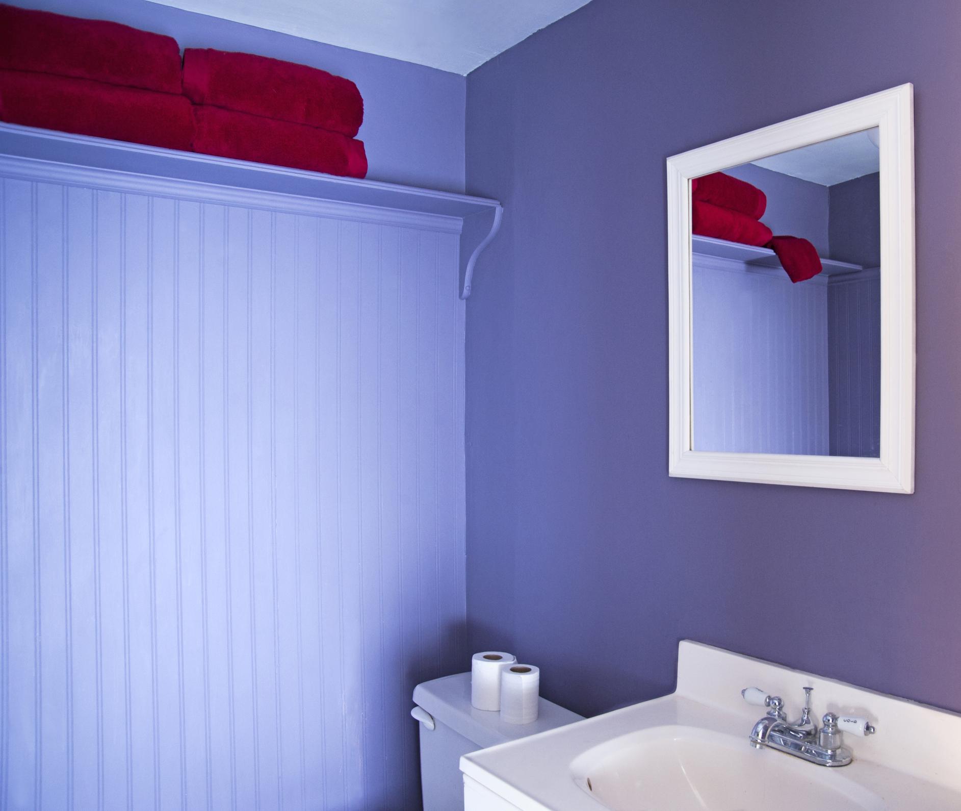 Mirror, sink and toilet in modern bathroom